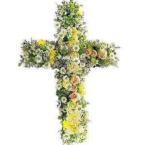 Cruz de condolencias en amarillos, pasteles y blancos